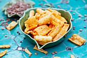 Lentil chips in a ceramic bowl