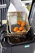 Frying ham croquetas