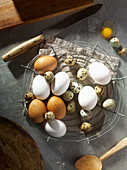 Brown and white hen's eggs with speckled quail's eggs