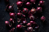 Red onions on a black background