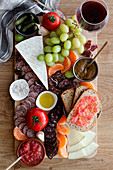Colorful fresh fruits, meat, vegetables and sauces for wine