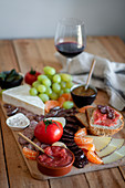 Fruits, meat, vegetables and sauces for wine