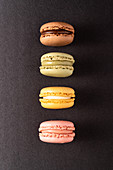 Colorful macaroons displayed on black background