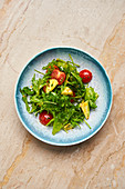 Fresh vitamin salad with rocket and tomatoes