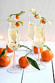 Sparkling wine with physalis and tangerines