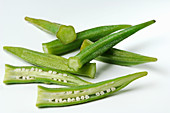 Fresh okra pods on a white background