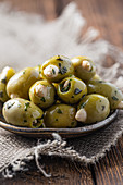 Green olives with herbs, stuffed with almonds