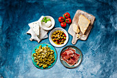 Antipasti: Various types of cheese, pickled olives, ham and pasta