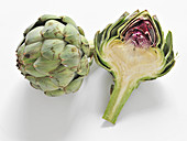 Artichoke, whole and halved on a white background