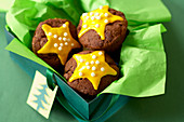 Christmas muffins with a yellow star and sugar pearls