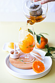 Pour tea on tangerine sorbet