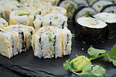 Cucumber and avocado sushi rolled in seaweed and yuba skins