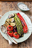 Grilled vegetables - tomatoes, red onion, zucchini, asparagus, red pepper, yogurt sauce