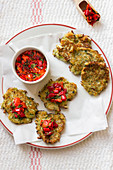 Halloumi and zucchini fritters with red pepper and parsley salsa
