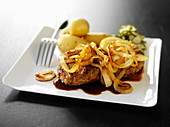Swedish mince steaks with melted onions