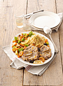 Oriental-style ossobuco with couscous, dried fruits and vegetables