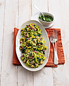 Pappardelle with Tuscan kale pesto, bacon and white beans