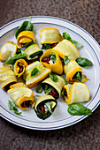 Zucchini rolls with sun dried tomatoes, gorgonzola and basil