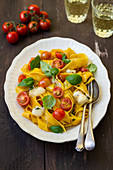 Tagliatelle with cherry tomatoes, goat cheese and basil