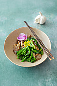 Water spinach, broccolini and oyster mushrooms in Thai oyster sauce