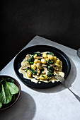 Potato gnocchi with creamy garlic mushrooms suce and spinach