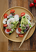 Avocado toast with radish and goat's cheese