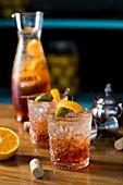 Aperol spritz, olive, orange zest