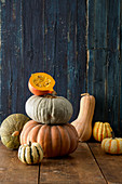 An arrangement of pumpkins with a halved Hokkaido pumpkin