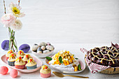 An Easter buffet of cupcakes, marzipan eggs, pavlova and hot cross buns