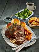 Roasted leg of lamb with Yorkshire puddings and vegetables (England)
