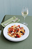 Paccheri with gurnard, cherry tomatoes and olives