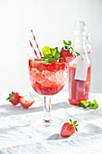 A summery strawberry spritzini made with strawberry purée, vodka and mint
