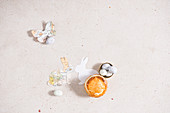 Small Torta Pasqualina, sugar eggs and paper Easter decorations