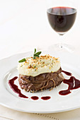 Tournedos Parmentier with a red wine and orange sauce