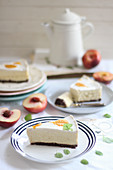 Three slices of cheesecake with peaches