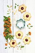 Flower-shaped biscuits with raspberry jam