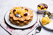 Vegan vanilla waffles with mango sorbet, soya cream and fruit