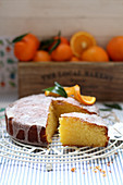 An iced orange cake, sliced