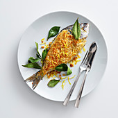 Bayleaf bream with a bread crust and lemon zest
