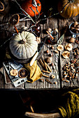 Autumn pumpkins, spices, nuts and dried fruits on the table