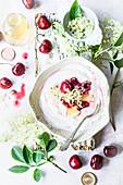 Yogurt with elderflower syrop and cherries