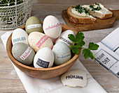 Eggs decorated with magazine clippings in various natural shades
