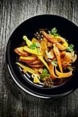 Pumpkin salad with carrots and mushrooms