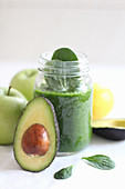 Avocado and apple smoothie with spinach
