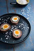 Meat roulade filled with hard-boiled egg and spinach