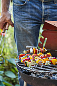 Vegan vegetable kebabs on a barbecue