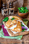 Pizza calzone with chicken and pepper