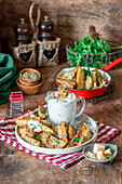 Baked potato wedges with sour cream and parmesan crust
