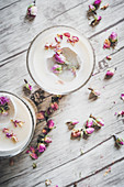 Chai lattes with rose petals and ice cubes