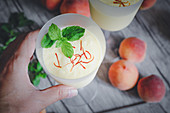 A peach smoothie with saffron and mint